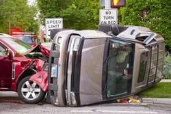 Depicts two cars post accident.
